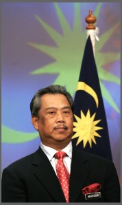 Malaysia's new Deputy Prime Minister Muhyiddin Yassin listens during a news conference to announce new cabinet ministers in Putrajaya